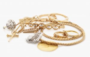 Pile of Gold Jewelry Including a Diamond Necklace Earrings Rings and a Bracelet
